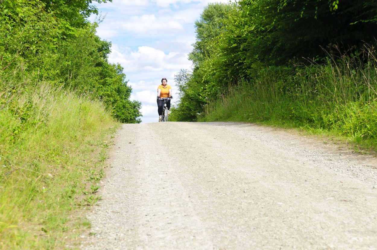 Check the weather report for wind before you ride. The truth is if you are biking against the wind you may go about 10 km/h slower than when you have a tailwind. You can ride more effortlessly and have more fun, but you'll still be getting exercise. One option is to hitch a ride or take public transportation to your destination if the winds aren't in your favor, and ride back with a tailwind.