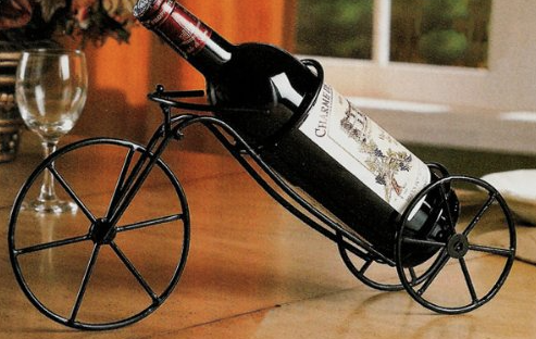 You definitely shouldn't drink and ride, but you can still enjoy wine in a cycling environment. How about this wine rack?