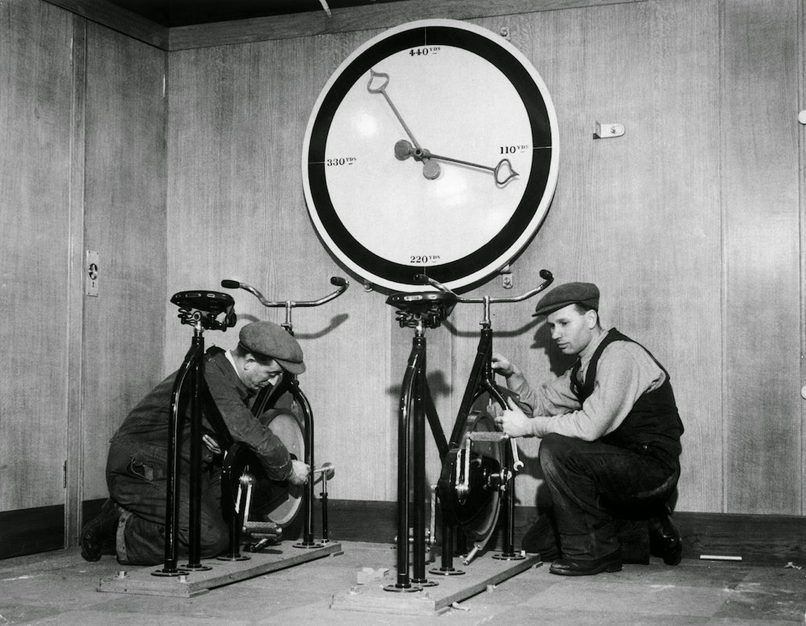 English liner Queen Mary and the setup of exercise bikes, with an enormous meter indicating the distance covered (1932).