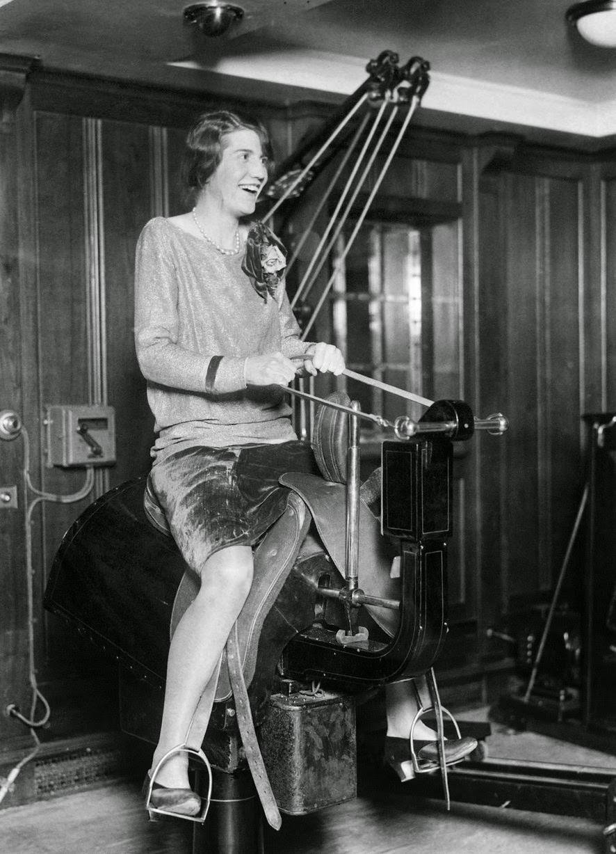 Passenger riding the electric horse in the gym on the liner SS Bermuda.