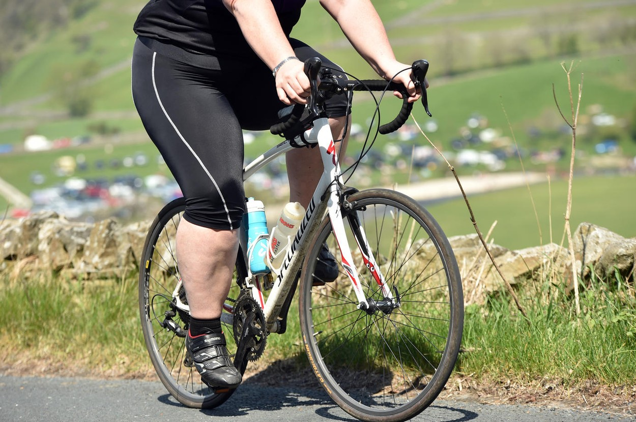 Overweight woman riding a bike in a Sportive, Yorkshire
