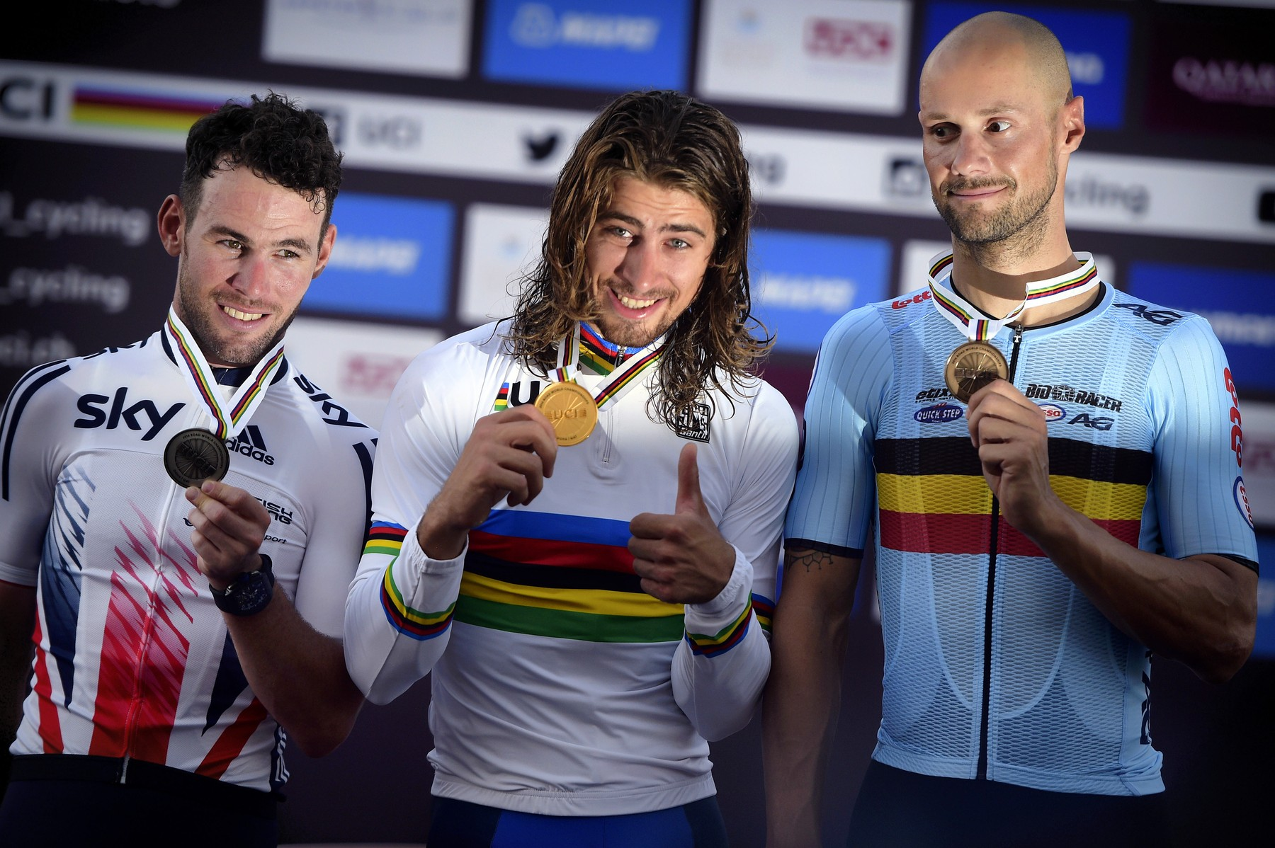 April 15, 2014 - Doha, QATAR - British Mark Cavendish of Dimension Data, Slovakian Peter Sagan of Tinkoff and Belgian Tom Boonen of team Etixx - Quick-Step pictured on the podium after the men's elite road race at the 2016 UCI World Road World Cycling Championships in Doha, Qatar, a race of 257.5 km from Doha to Doha, Sunday 16 October 2016. BELGA PHOTO YORICK JANSENS, Image: 302981991, License: Rights-managed, Restrictions: * Belgium, France, Germany, Luxembourg and Netherlands Rights OUT *, Model Release: no, Credit line: Profimedia, Zuma Press - News