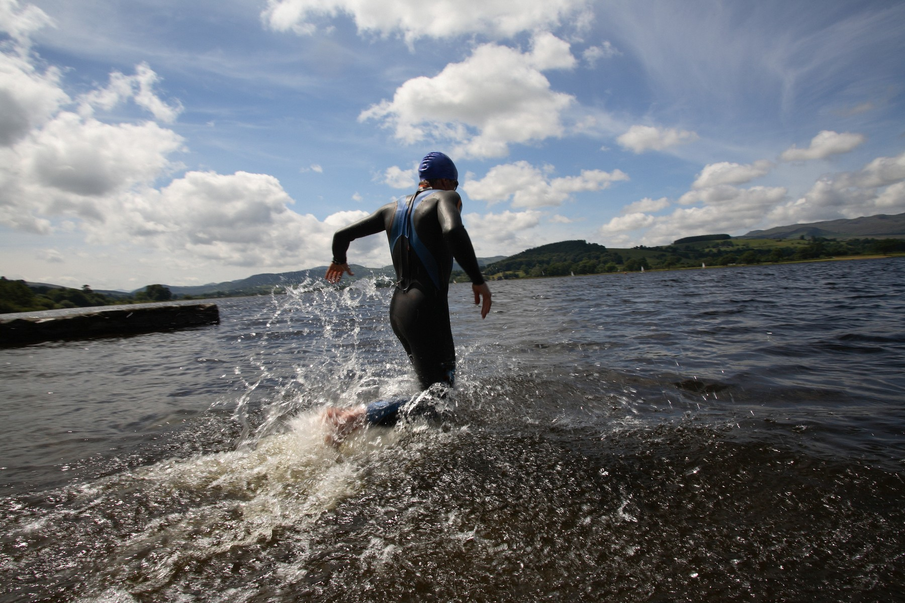 Triathlete swimmer running into water