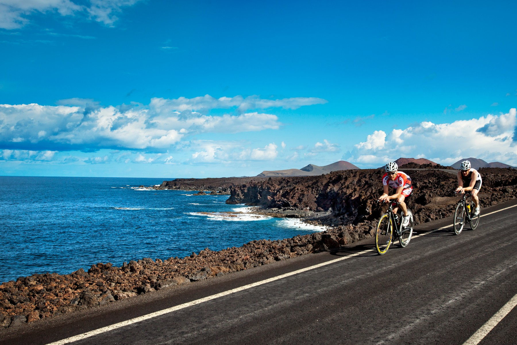 Cyclists at cliff coast, Los Hervideros, Lanzarote, Canary Islands, Spain, Europe, Image: 151243631, License: Rights-managed, Restrictions: , Model Release: no, Credit line: Profimedia, LOOK-foto