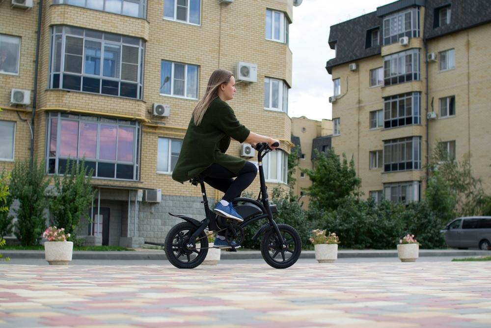 Woman Riding E-Bicycle