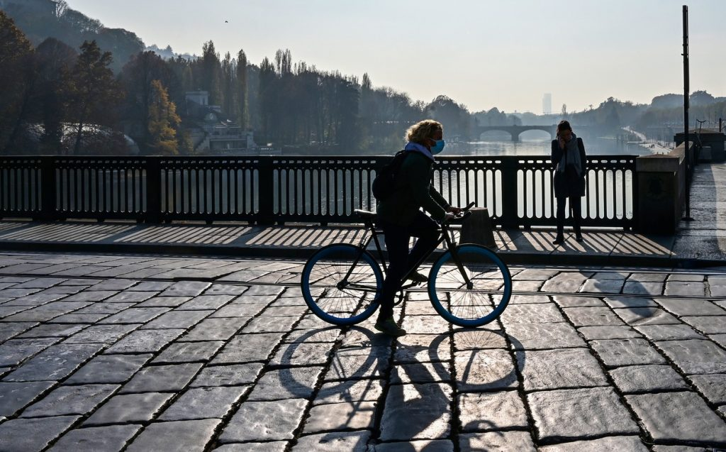 Woman cycling in a city