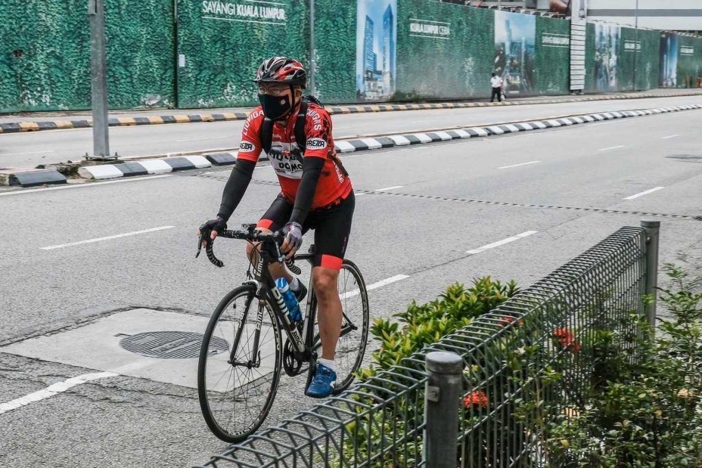 Cycling with a mask